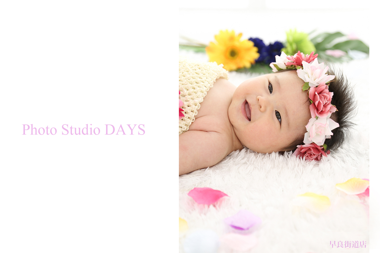 花冠でにっこり笑顔のハーフバースデーの写真
